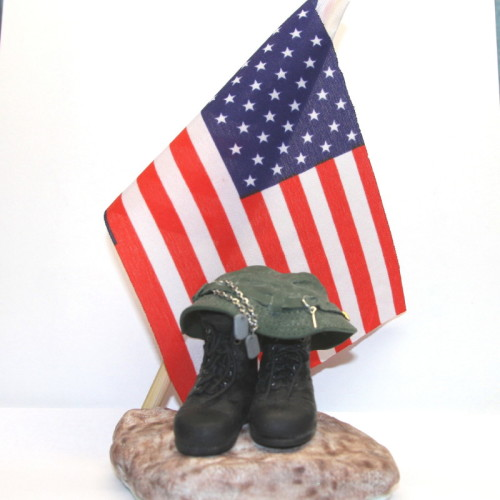 military sculpture with american flag