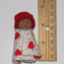 Valentine Baby doll next to ruler