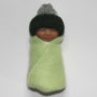 Miniature baby doll in green
