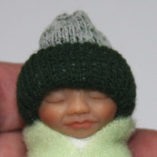 green baby bundle face
