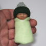 green baby doll bundle in hand