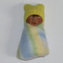 Miniature baby doll with yellow ears hat
