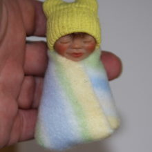 yellow ears baby bundle in hand