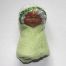 light green baby girl doll
