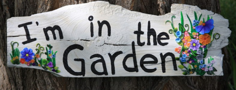 I'm in the Garden Sign Next to Tree